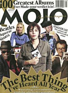 Elvis Costello (ngoài cùng bên phải) giữ bản phát hành mang tên Ron Sexsmith trên bìa tạp chí Mojo số tháng 1 năm 1996